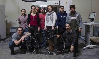 Designerteam mit Fahrrad.