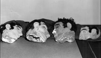 Pappmaché Köpfe der vier Häftlinge