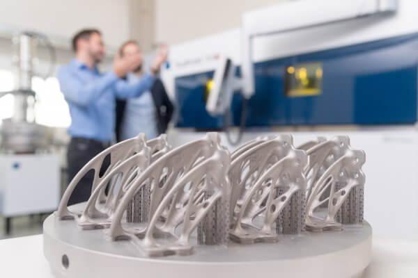 Mit TruPrint 5000 3D-Drucker in Serie gefertigte Teile.