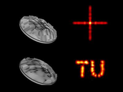 Die Kunststofflinse und das Logo der TU Wien