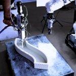 Roboterarm von Baubot beim 3D-Druck