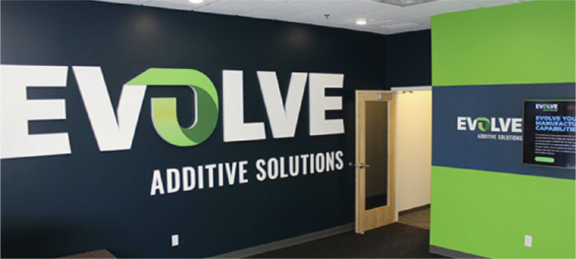 Evolve Additive Solutions Schriftzug in Büro