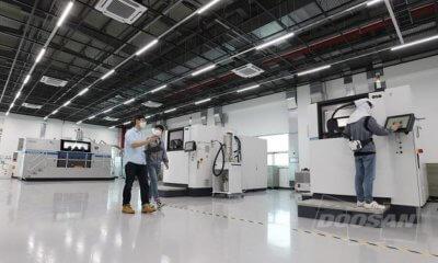 3D-Drucker und Mitarbeiter